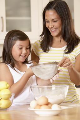 Mom and Daughter Cooking with Flour