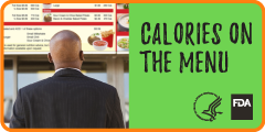 Man looking at menu board with calories featured on the menu