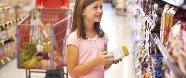 Girl Reading the Food Label