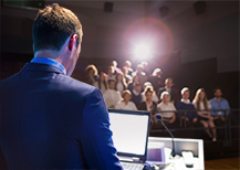Man giving announcement to audience