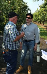 FDA Commissioner Scott Gottlieb, right, talks with farmer Gary Willis in Hood River, Oregon.