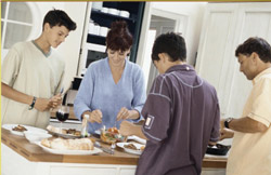 food ingredients additives and colors - family prepares meal in kitchen