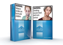 Two cigarette packs with FDA warnings.