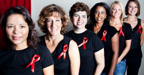 women wearing black shirts w red ribbons