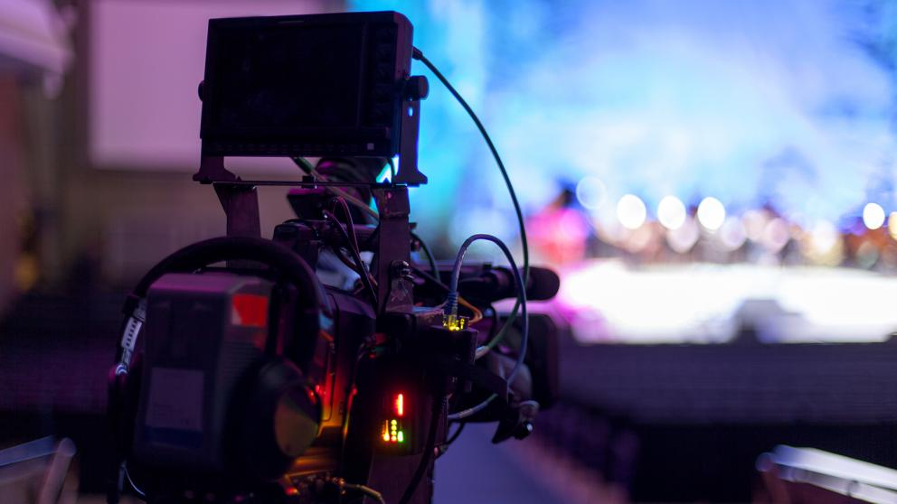 Professional digital video camera set up at an event