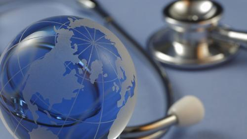 A photo of a globe and a stethoscope