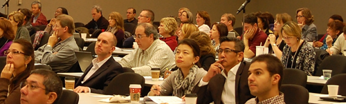 Audience Participating in Scientific Professional Development Lecture