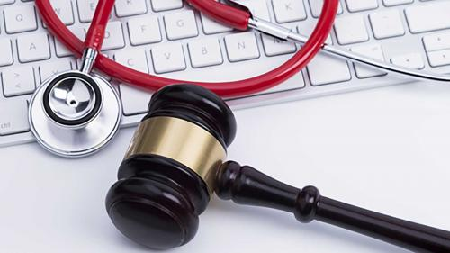 Laptop, gavel, and stethoscope, representing online resources
