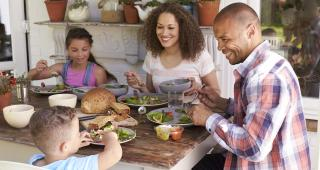 Mutual Reliance Banner of Family eating meal together