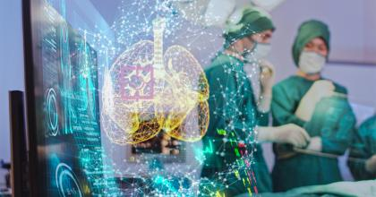 Digital rendering of lungs superimposed over an image of two surgeons looking at a screen.
