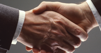 image of a hand shake, symbolising collaboration