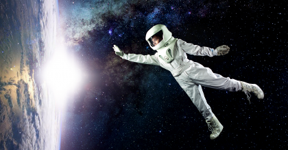 Image of woman floating in Space reaching out to planet Earth