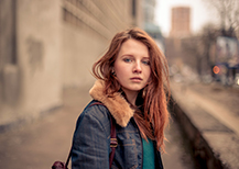 Teen girl in denim jacket