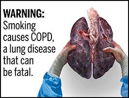 "A rectangular cigarette health warning with a white background and black text that reads: ""WARNING: Smoking causes COPD, a lung disease that can be fatal."" To the right of the text is a photorealistic illustration showing gloved hands holding a pair of diseased, darkened lungs removed from a smoker with COPD. The warning is surrounded by a black outline."