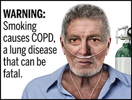 "A rectangular cigarette health warning with a white background and black text that reads: ""WARNING: Smoking causes COPD, a lung disease that can be fatal."" Next to the text is a photorealistic illustration showing a man receiving oxygen support because he has COPD caused by cigarette smoking. The illustration shows the head and neck of a man (aged 50-60 years) who has a nasal canula under his nose supplying oxygen; the oxygen tank is behind his left shoulder. The warning is surrounded by a black outline."