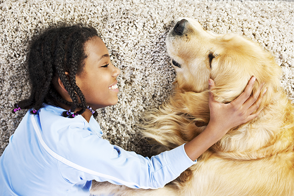 Girl with dog on carpet (600x300)