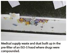 Medical waste and dust built up in pre-filter of ISO-5 hood