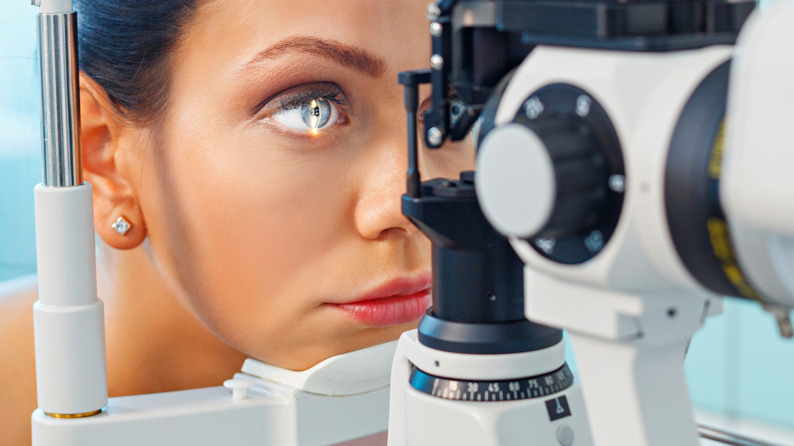 Woman having eyes examined by ophthalmologist