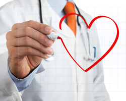A physician is drawing a heart symbol