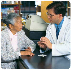 Pharmacist explaining details of a prescription medication to a customer