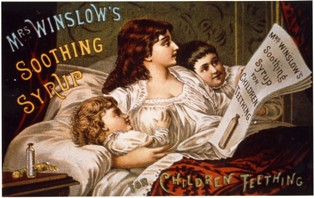 A lady in bed with a little girl on the right and a little boy on the left. She is reading a piece of paper with says, Mrs. Winslow's Soothing Syrup