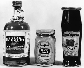 Three bottles with labels on the front of each.