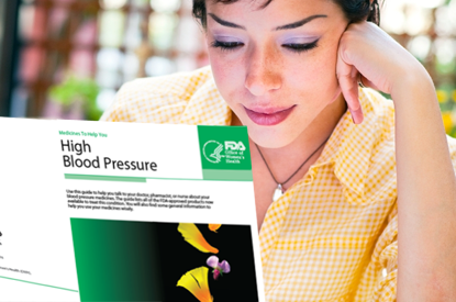 Woman reading pamphlet on High Blood Pressure