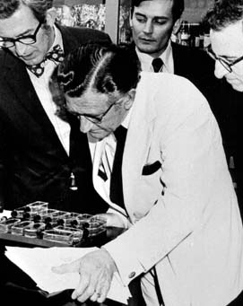 Rep. L.H. Fountain and three other men examining a group of laboratory dishes