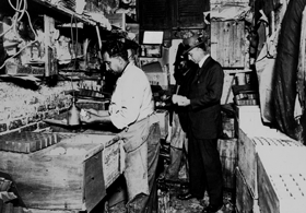 Baltimore Inspector Earnshaw inspects a dirty egg packing facility circa 1912. (v2)