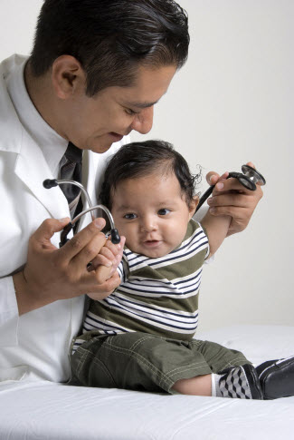 Doctor playing with baby