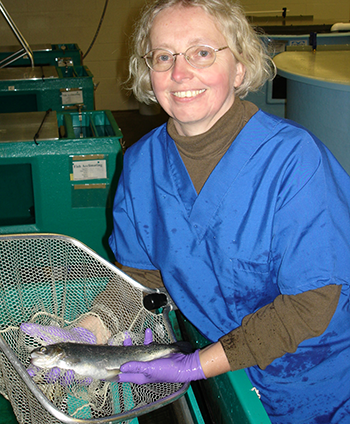 Renate Reimschuessel holding trout at CFSAN lab (350x424)