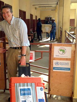 Professor Miles Carroll arrives at an EVIDENT facility in Guinea with research equipment (Image: EVIDENT)