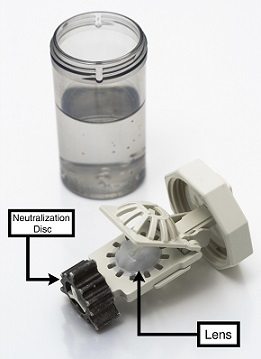 Image showing hydrogen peroxide solution, as well as neutralization disc and lens.