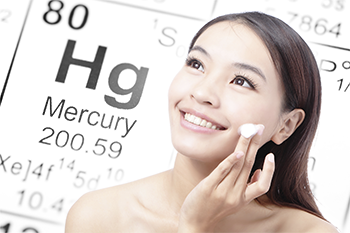 Woman putting on skin cream with mercury element in the background